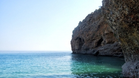 Swim to the caves at the two extremities of the beach!
