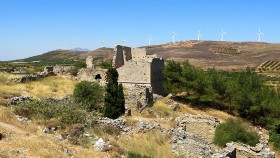 The medieval village of Voila flourished during the15th-19th century|||The Ottoman Gate of the tower|Almost intact, the interior of the house|And in the horizon, wind generators...|The chapel of Agios Georgios|The fresco over the tomb|