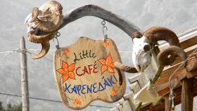 The 'Little Cafe' in Kallikratis welcomes you!|The herbal goodies of 'Little Cafe'|A herbal sanctuary in the middle of nowhere|The Cretan Far West welcomes you|Cretan mountain tea (aka malotira) in Kallikratis|Mr. Yiannis in action!|Red hot chilli peppers anyone?|Passing the knowledge to the new generation|A few of the things you will find in Kouses|Cretan cuisine & Cretan herbs in Tsakalakis' cafe|Welcome to Nivritos|For the cold winter days & nights...|Yes, you may also order a coffee (Nivritos)